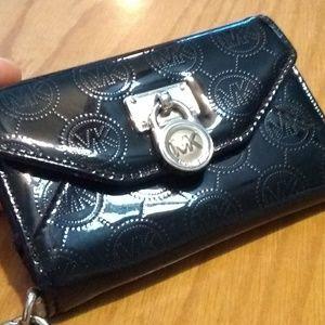 Michael Kors wallet wristlet cell phone holder.